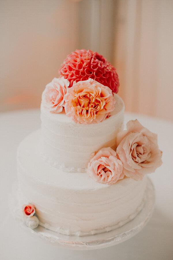 orange and pink wedding cake created by Kristi S Kustom Kakes in Spencer WI
