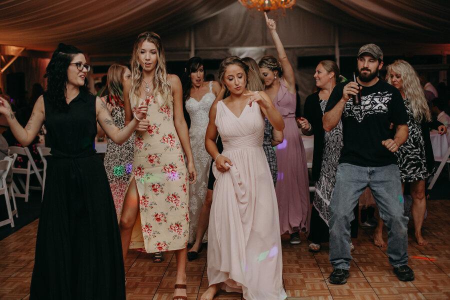 dancing wedding party having fun at par 4 resort in Waupaca WI