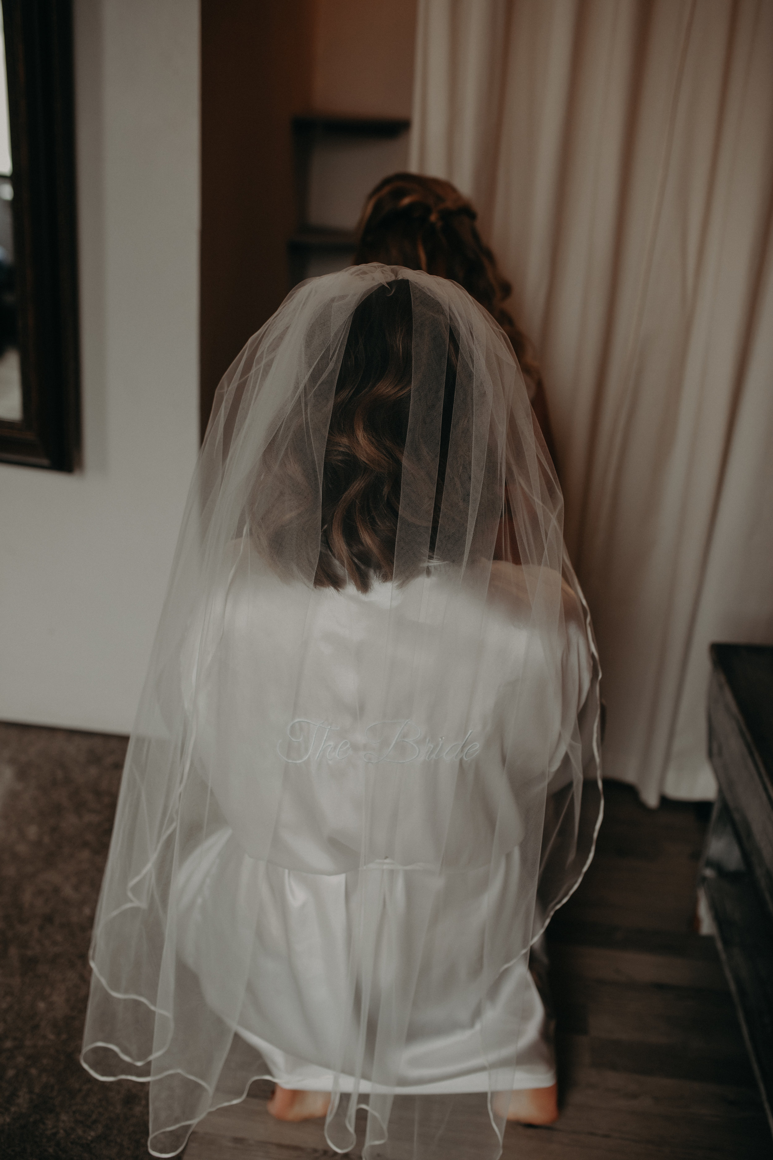 bride in robe with veil on gets ready at The Loft at Studio J in Stillwater MN