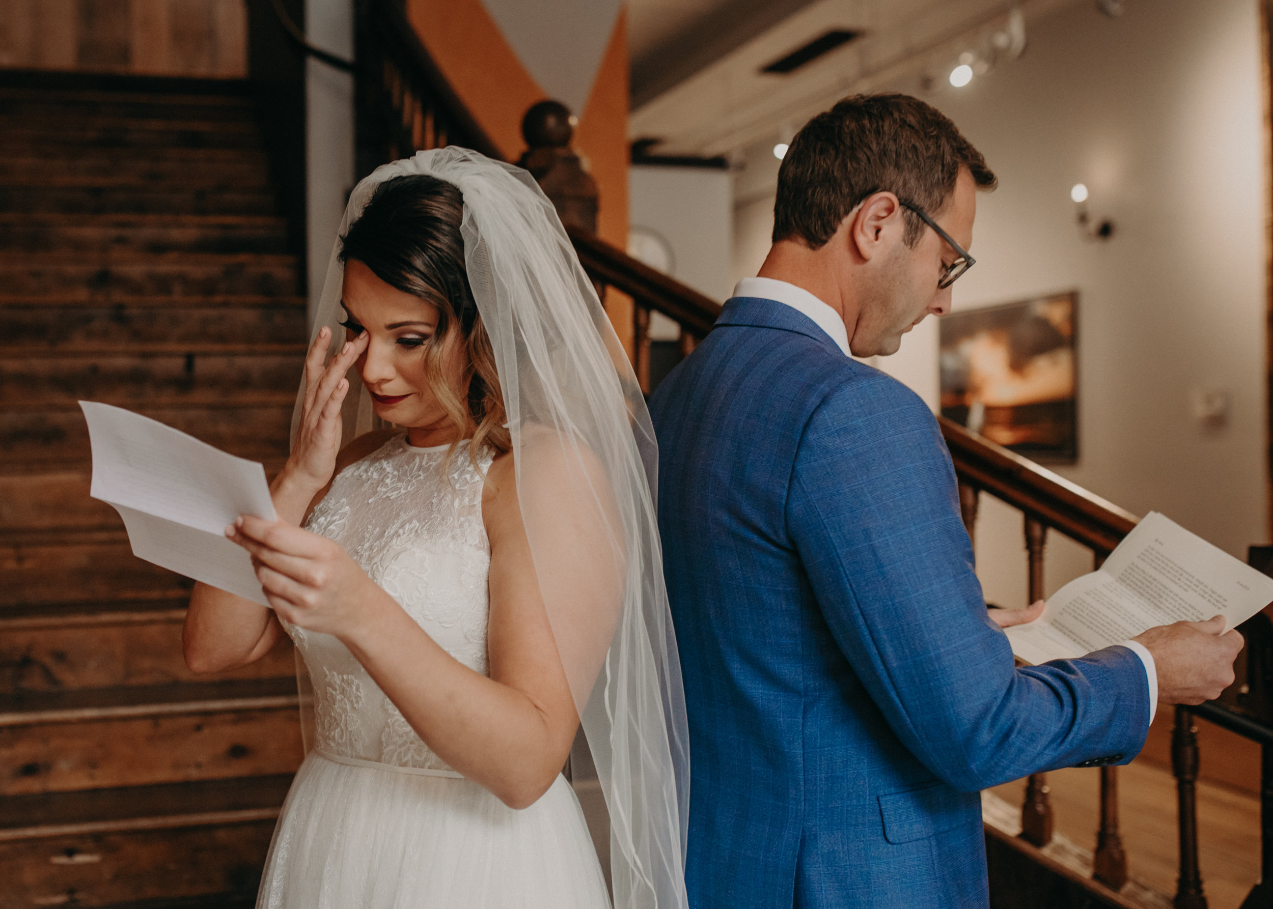 a bride cries during emotional letter reading at The Loft at Studio J while being photographed by Andrea Wagner Photography