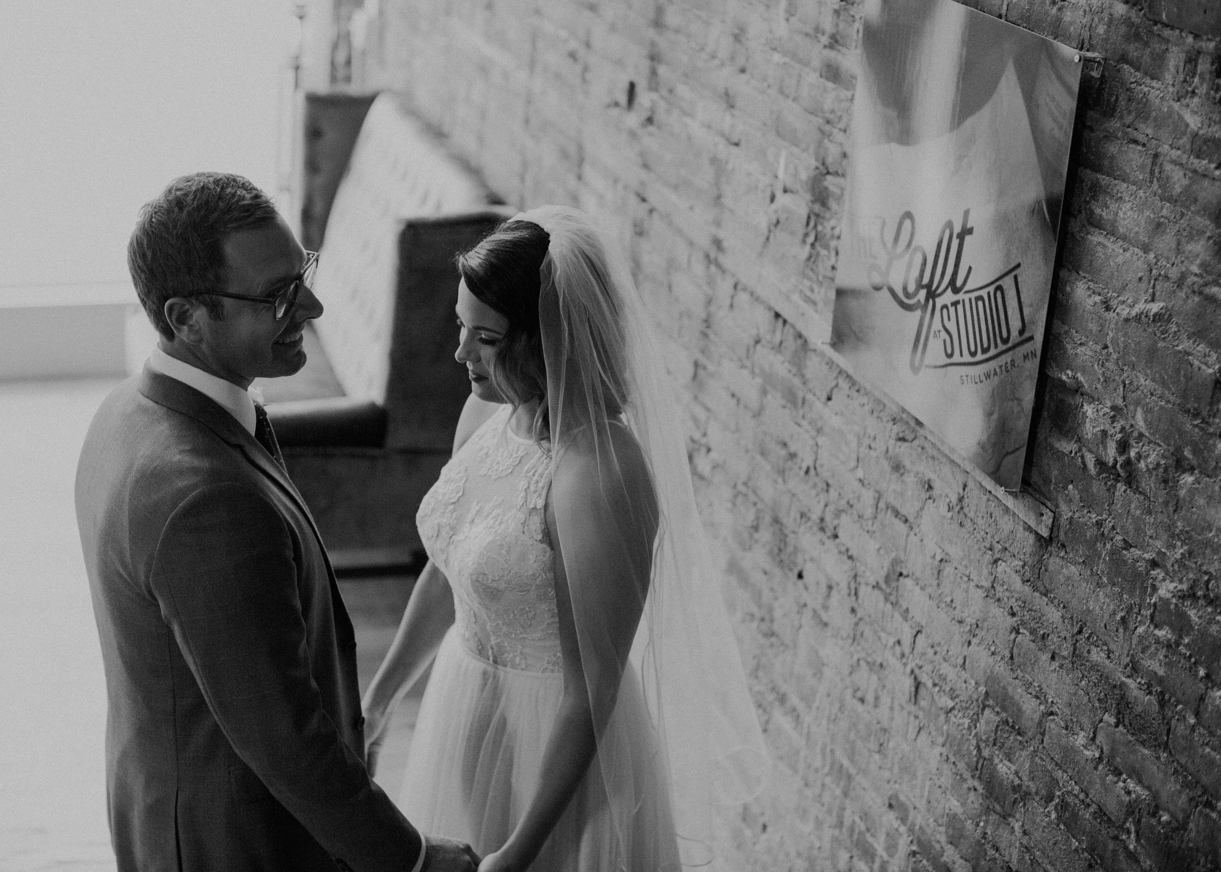 moody photographer captures raw and real moments at Stillwater MN wedding venue The Loft at Studio J