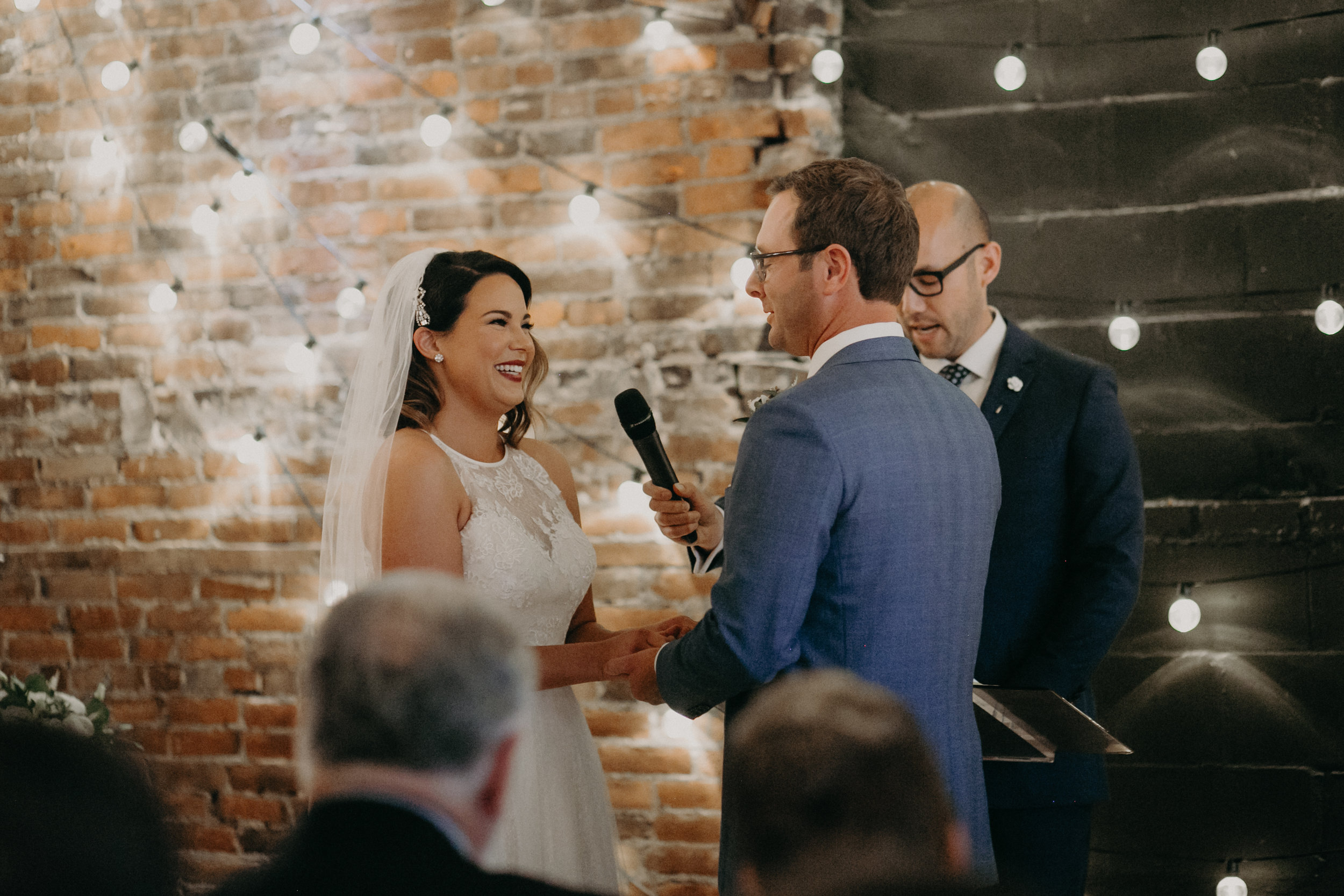 Andrea Wagner photography captures dimly lit and intimate wedding ceremony at The Loft at Studio J