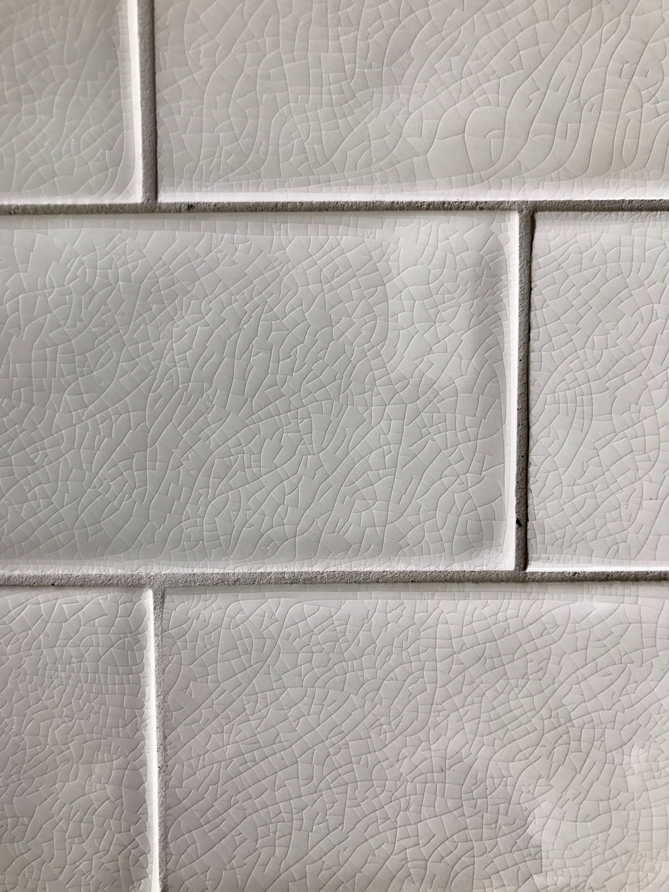 Subway wall tile details, love the crackling!