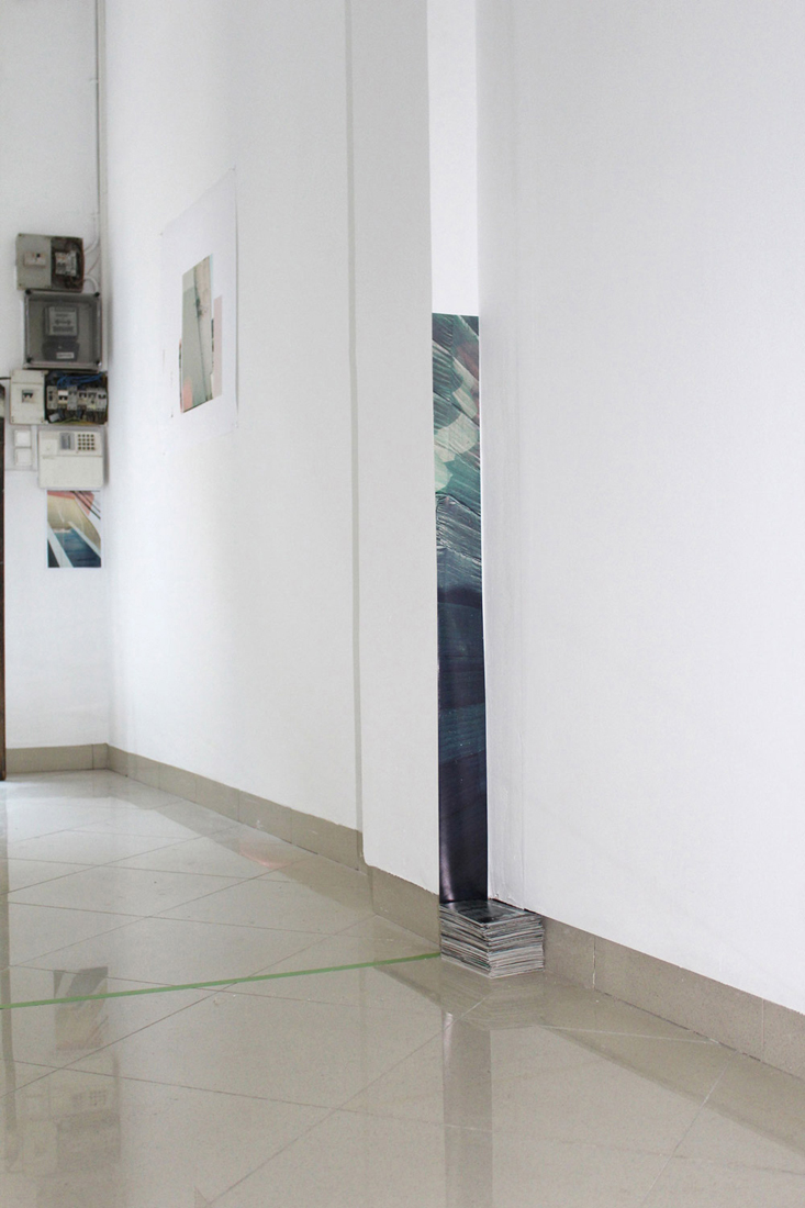 Coloured Cut [Blue] with pile of photographic prints. 2015. Installation View Detail. WTA Artspace, Barcelona.