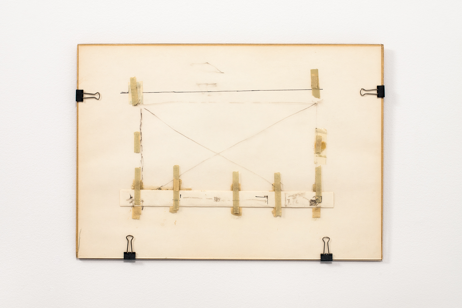 Nahum Tevet, Untitled #1, 1972. Cardboard, paper, binder clips, masking tape, transparent tape, and marker on glass, 13 3/4 x 19 13/16 x 7/16 in. (34.9 x 50.3 x 1.1 cm). Collection of the artist. Photo by Polite Photographic, courtesy of the Hunter College Art Galleries and the artist.