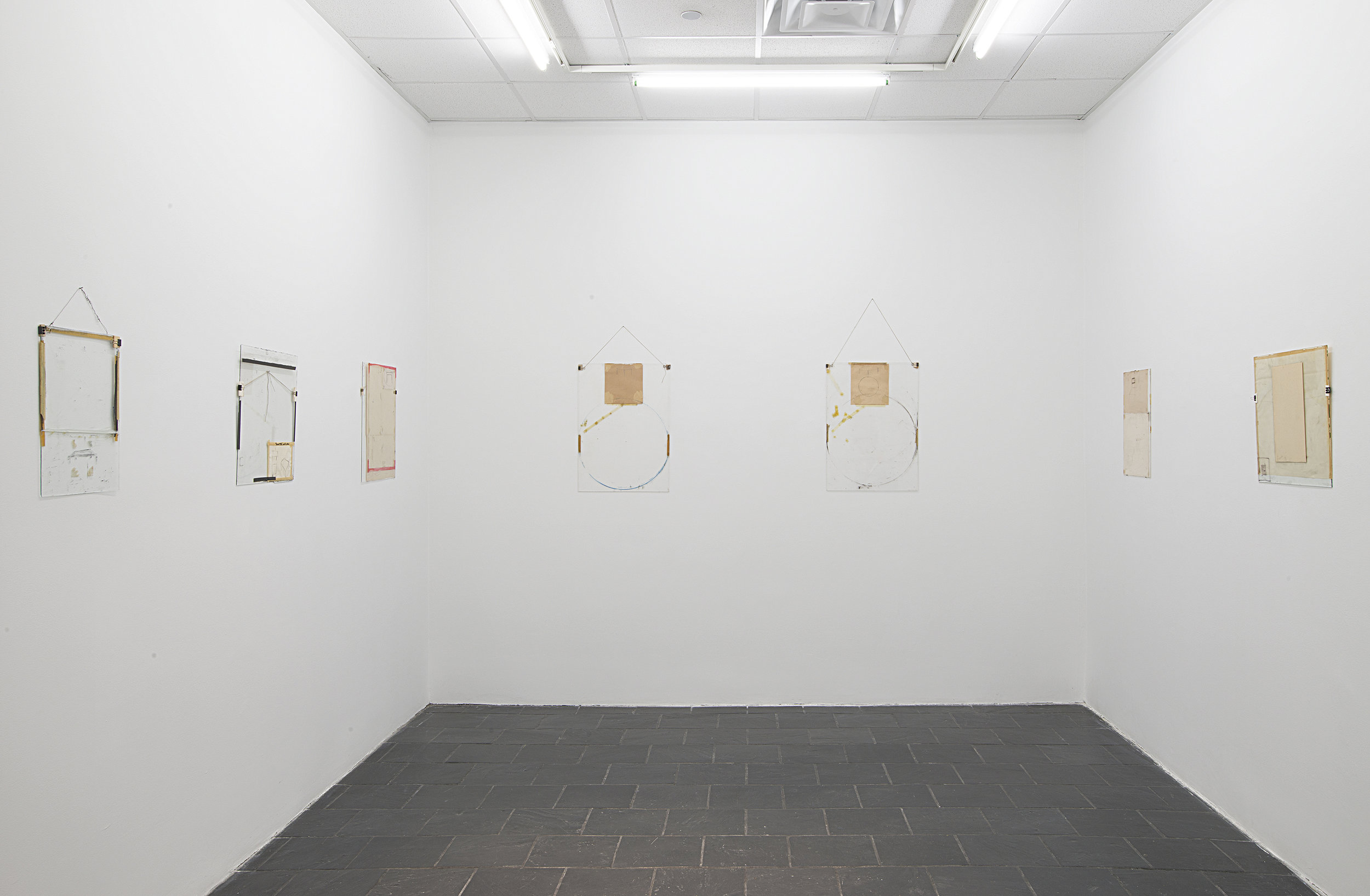 Installation view: Nahum Tevet: Works on Glass, 1972–1975 , Hunter College Art Galleries, 2016. Photo by Bill Orcutt.Left to right: Untitled #14, 1974; Untitled #29, 1975; Untitled #33, 1975; Untitled #30, 1975; Untitled #32, 1975; Untitled #36, 1975; Untitled #24, 1975.