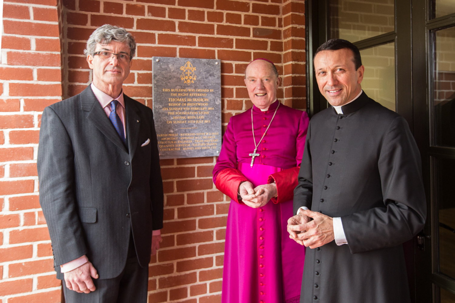 Architect, Bishop and Priest celebrate the Parish Centre -