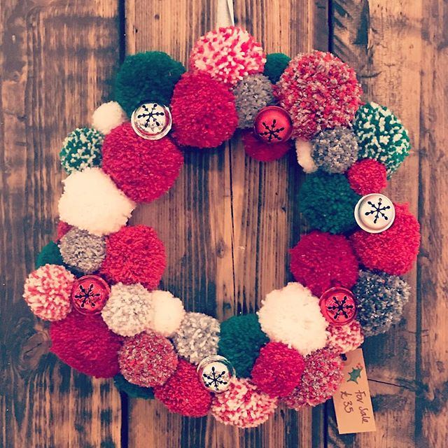 Christmas Pom Pom wreath available for sale at Bakers hair for £35