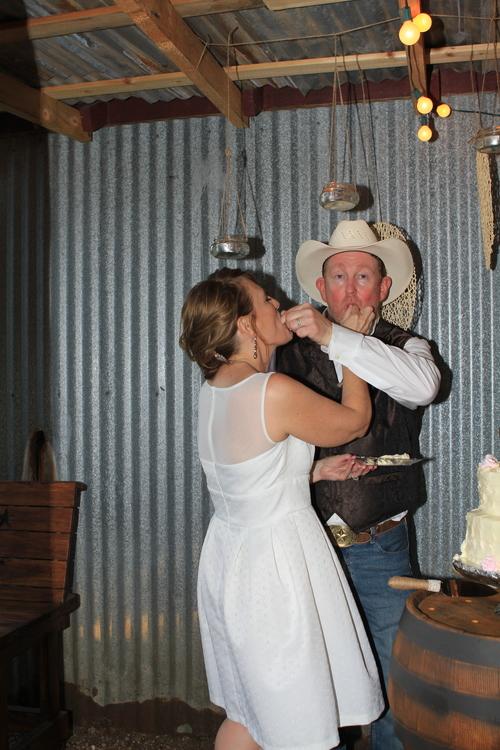 Driftwood TX + Wedding+ cake Feeding.jpg