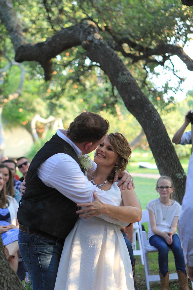 Rustic themed +wedding+first kiss.jpg