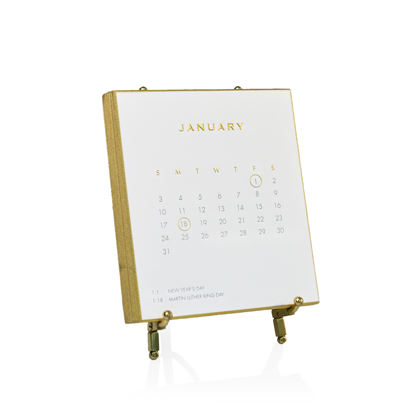 This beautiful calendar is available at Bespoke Designs in Westport. It is made with 2 color letterpress, high quality 2-ply European cotton paper. The beveled edges are hand painted with gold. It comes with a simple gold stand. $145
