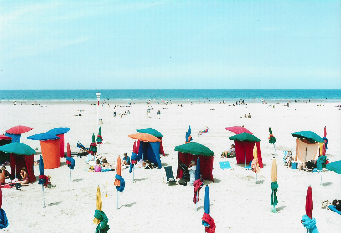 Massimo Vitali  Deauville Umbrellas, France , 2012 chromogenic print with Diasec mount 60 x 72 in. edition of 6