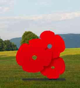 Donald Sultan  Big Red Poppies, 2015 , 2015 3/4 in. thick painted aluminum 72 x 72 in.on 1 1/4 x 11 1/2 x 63 in.base  edition of 6  Comes with powder coat painted black aluminum base. A polished stainless steel base is available for an additional charge.  Also available in 96 x 96 in.version