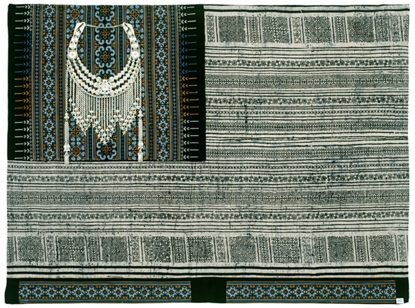 Muriel Stockdale  Hmong,  2009 traditional hand embroidery and hemp cloth with celebration choker 24 x 36 in.