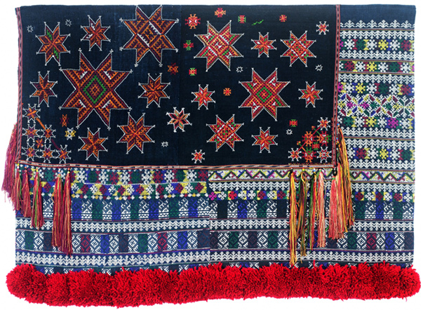 Muriel Stockdale  Mien,  2009 traditional embroidery on pieces of trouser and head gear 25 x 36 in.