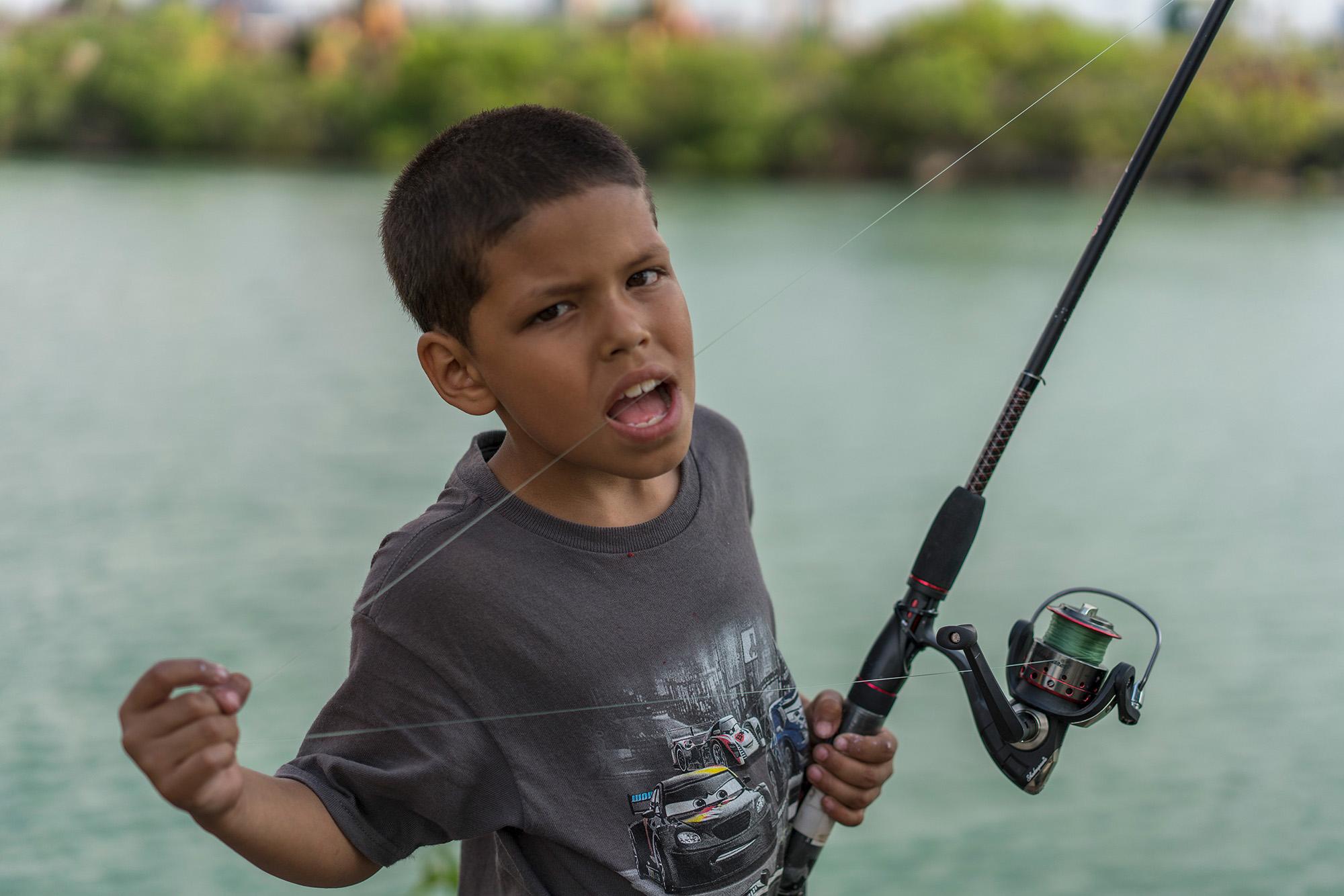 024_Peter_Essick-Fisherman_Rouge_River_Michigan.jpg