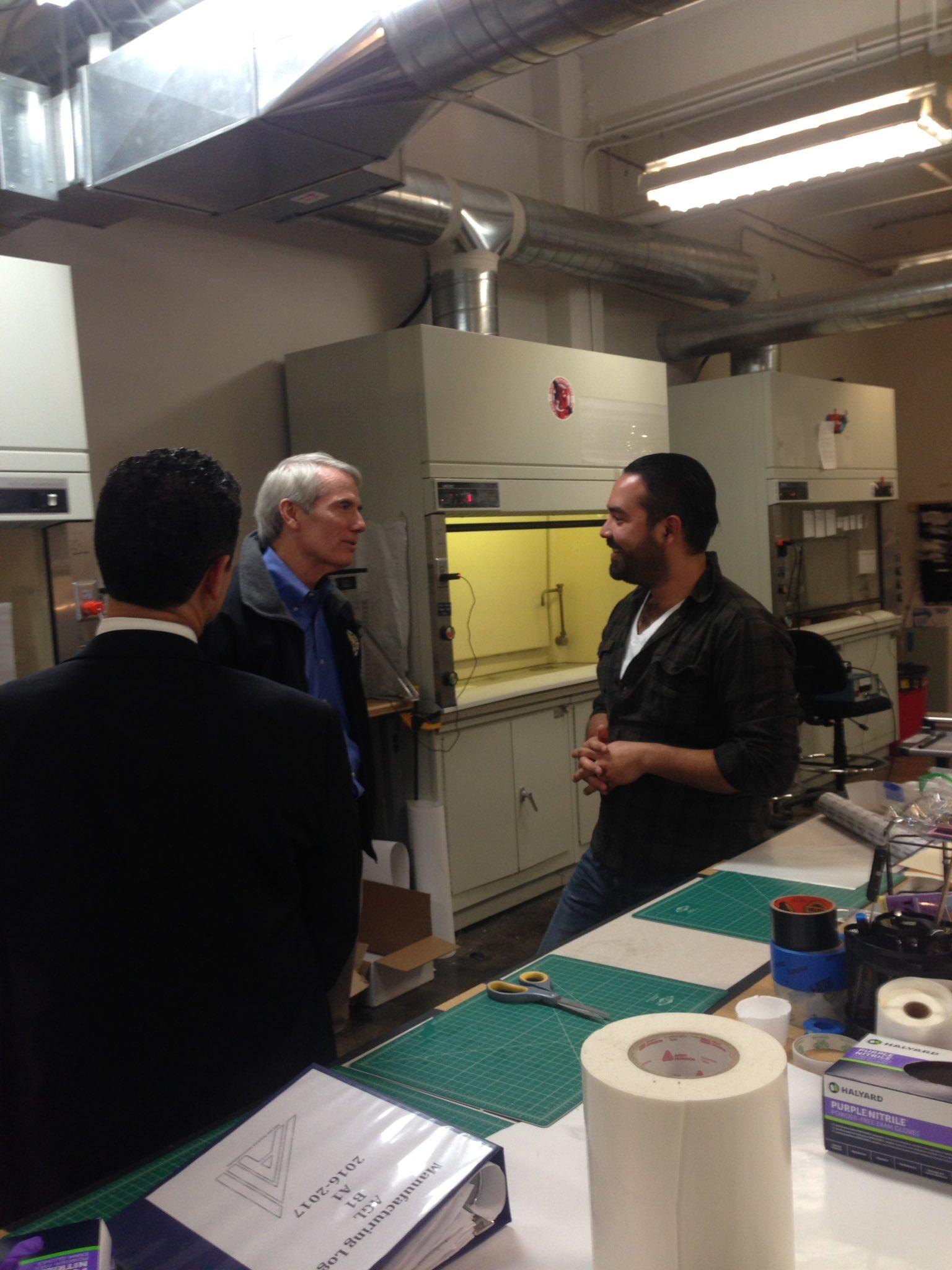 Ali Blandon explaining dry adhesion and electrospinning to Senator Rob Portman and Akron Accelerator CEO Anthony Margida.