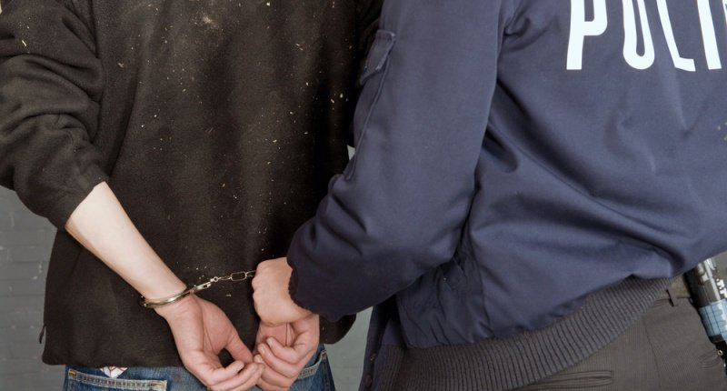 Police-officer-with-suspect-in-handcuffs-via-Shutterstock-800x430.jpg