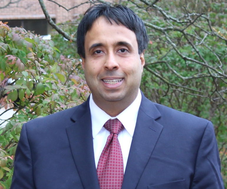 Herman Singh Dhade,  Director, Attorney at law