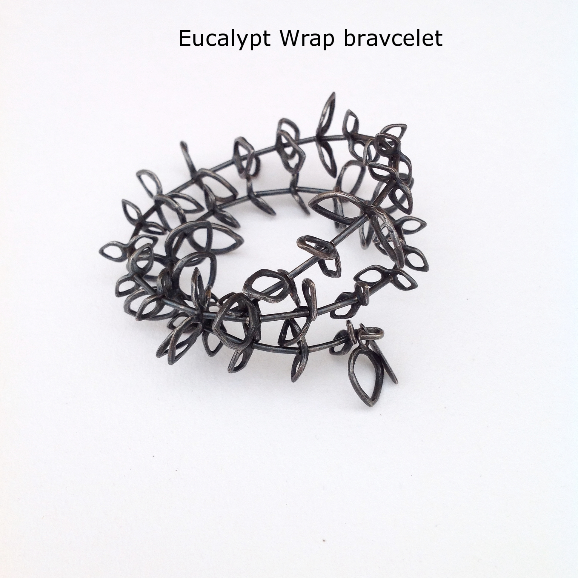 Oxidized sterling with memory wire, Eucalypt inspired bracelet adjustable size by Valerie Mitchell.