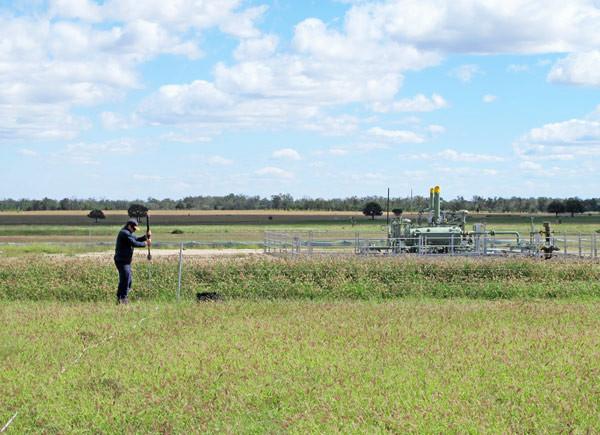 Doug sampling soil for methane.jpg