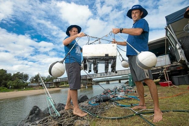 Dr Douglas Tait Research scientist with SCU national marine science centre and PHD candidate Luke Jeffery with some of their water testing equipment at Coffs Creek.