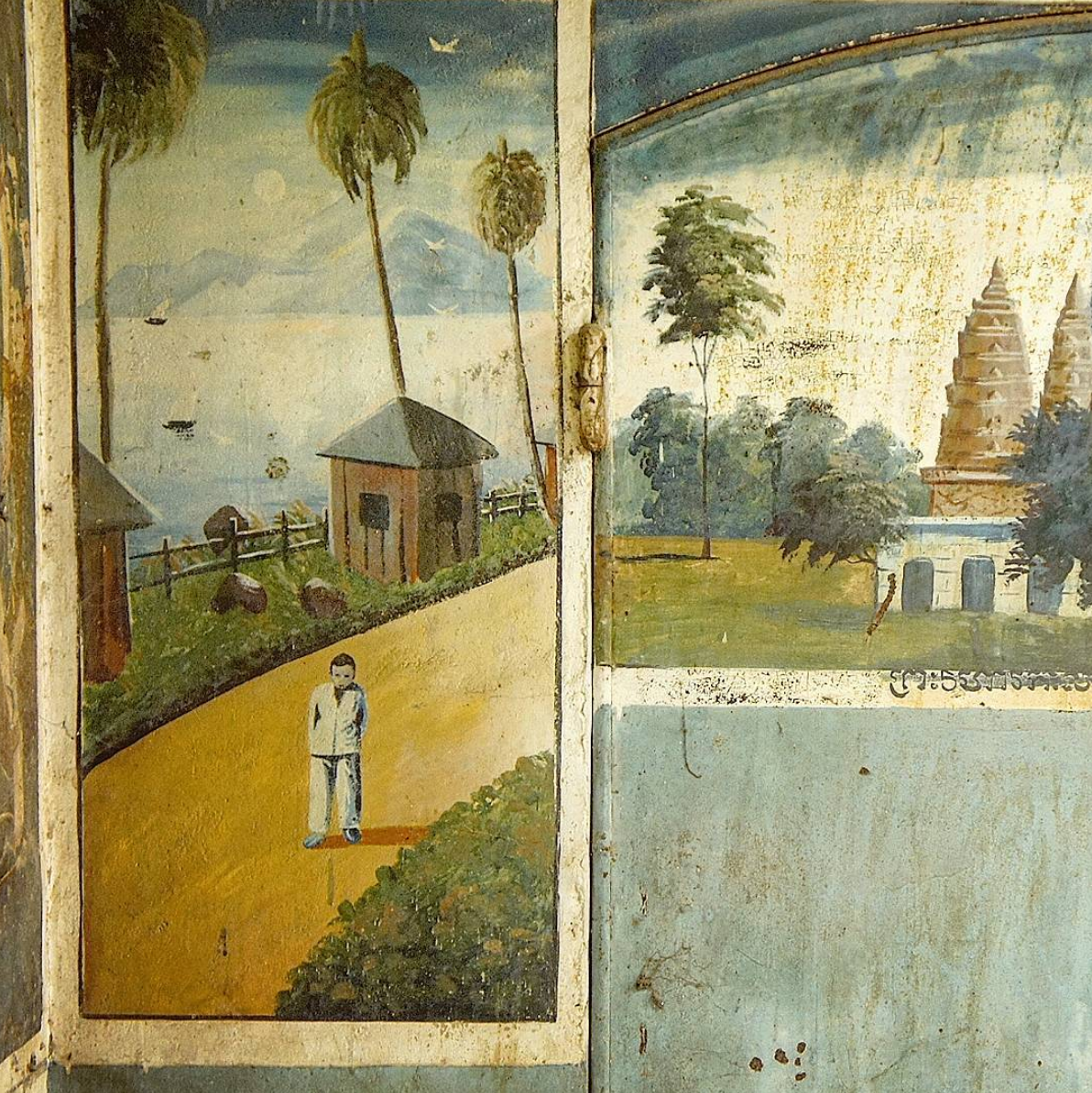 M  mural  on the interior walls of a family crypt at a local pagoda