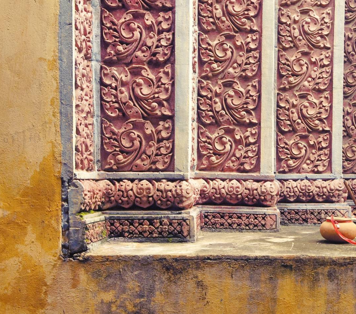 Wall of the crematorium in the grounds of the Chak Angkre Krom pagoda