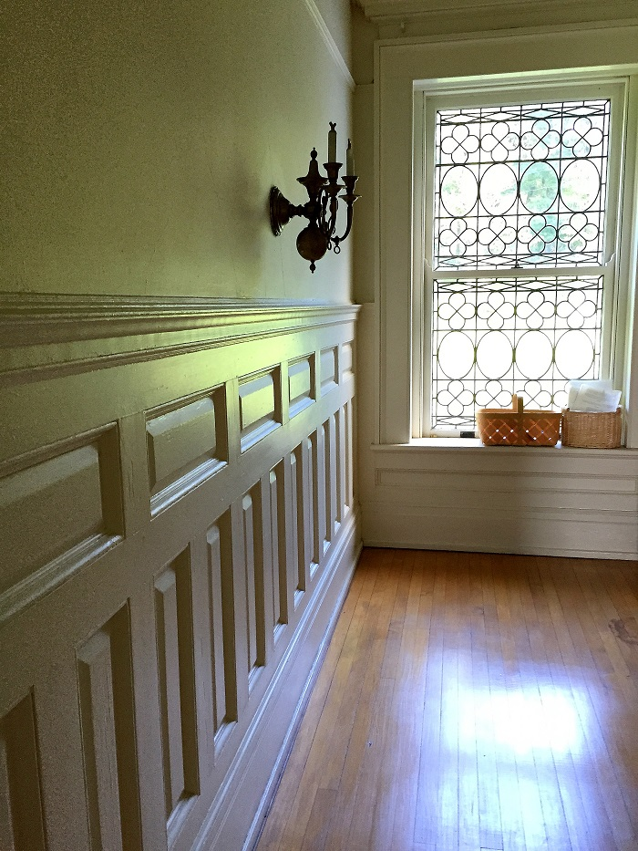 wainscotting, window mullions, sconces