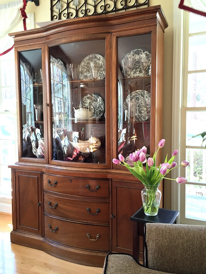 Storage furniture doesn't have to be traditional bookcases or cabinets. An antique breakfront can house all sorts of goodies in it while looking elegant and pulled together.