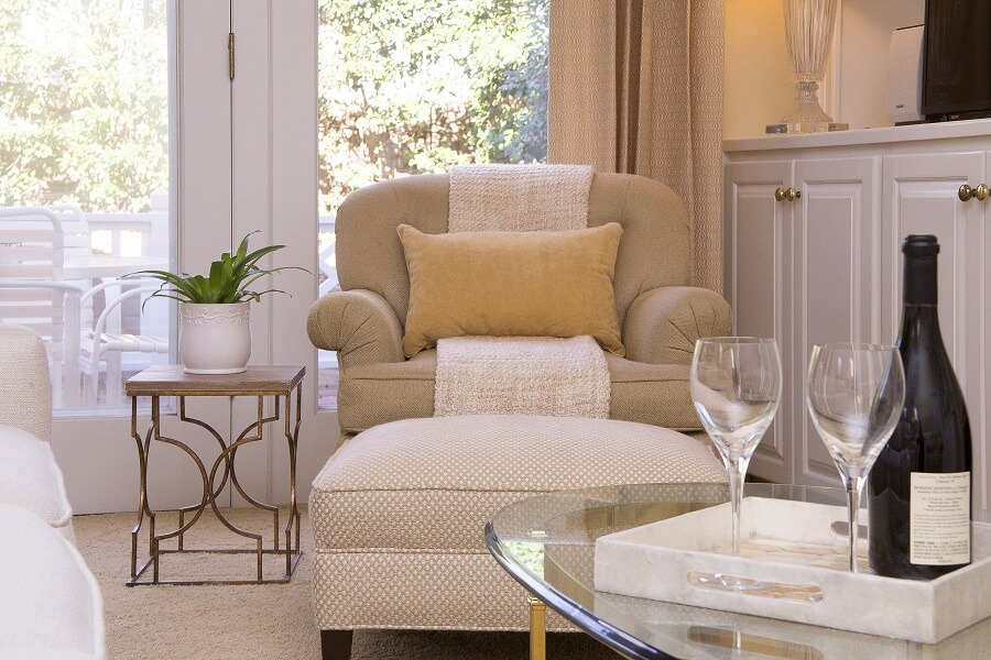 Accessories add interest and comfort to a neutral chair.