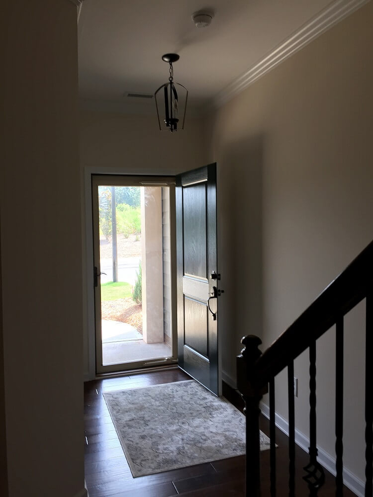 beige foyer with small light fixture