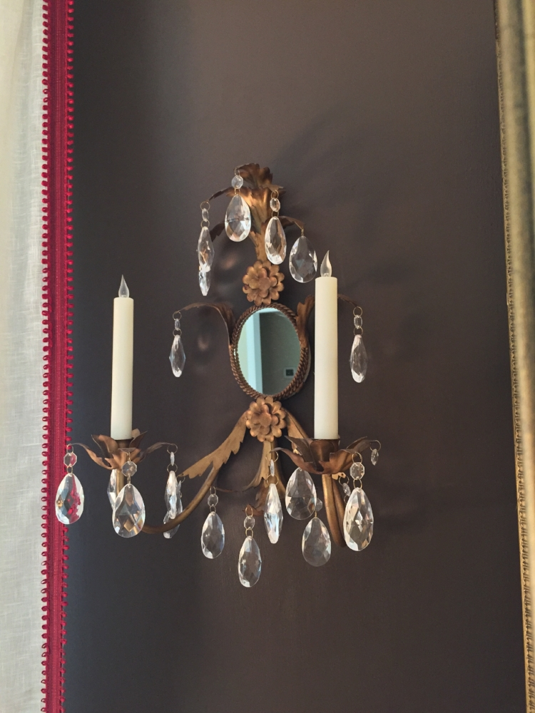 UPDATE!  I hung the sconces on an accent wall in our Living Room.  New LED candles are on their way as I type.  Yes!  Projects in designer's homes can stretch on for a very long time!  LOL!