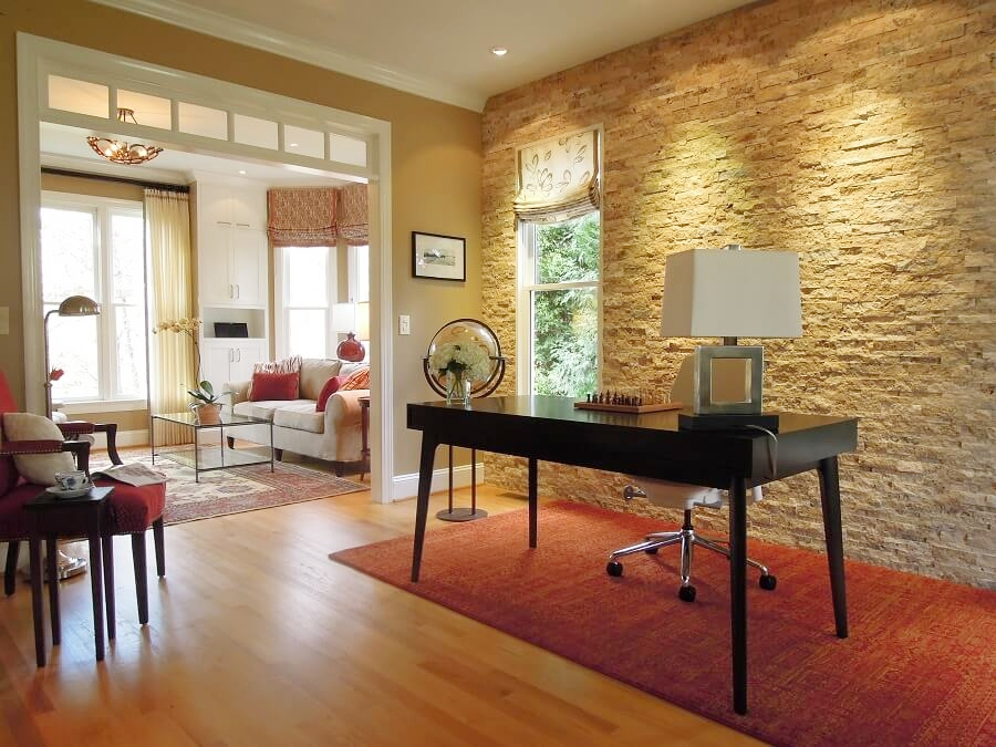 An accent wall of stacked travertine stone adds sparkle and texture to this gorgeous home office in Chapel Hill, NC.