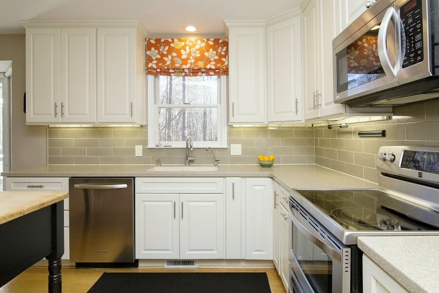 Taking cabinets all the way up makes a HUGE difference in an older home with 8 foot ceilings.