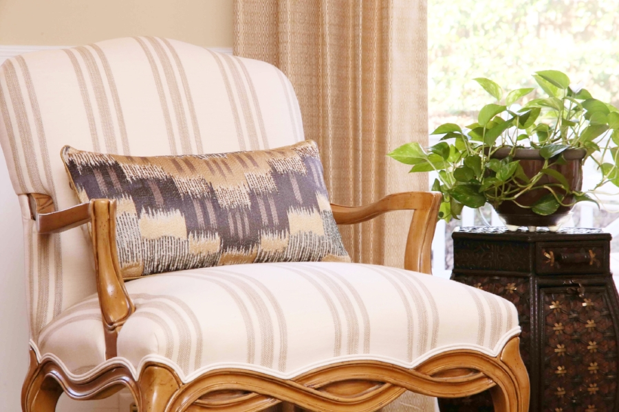Fresh fabric on a treasured chair - and a sparkly new accent pillow - bring new life and enjoyment to this Raleigh home.