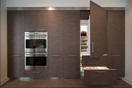 Built-in – Panel Ready Fridge – FLUSH Installation. The refrigerator panel doors line up perfectly with doors on either side of it. You'll also notice the built-in ovens are also a FLUSH installation.