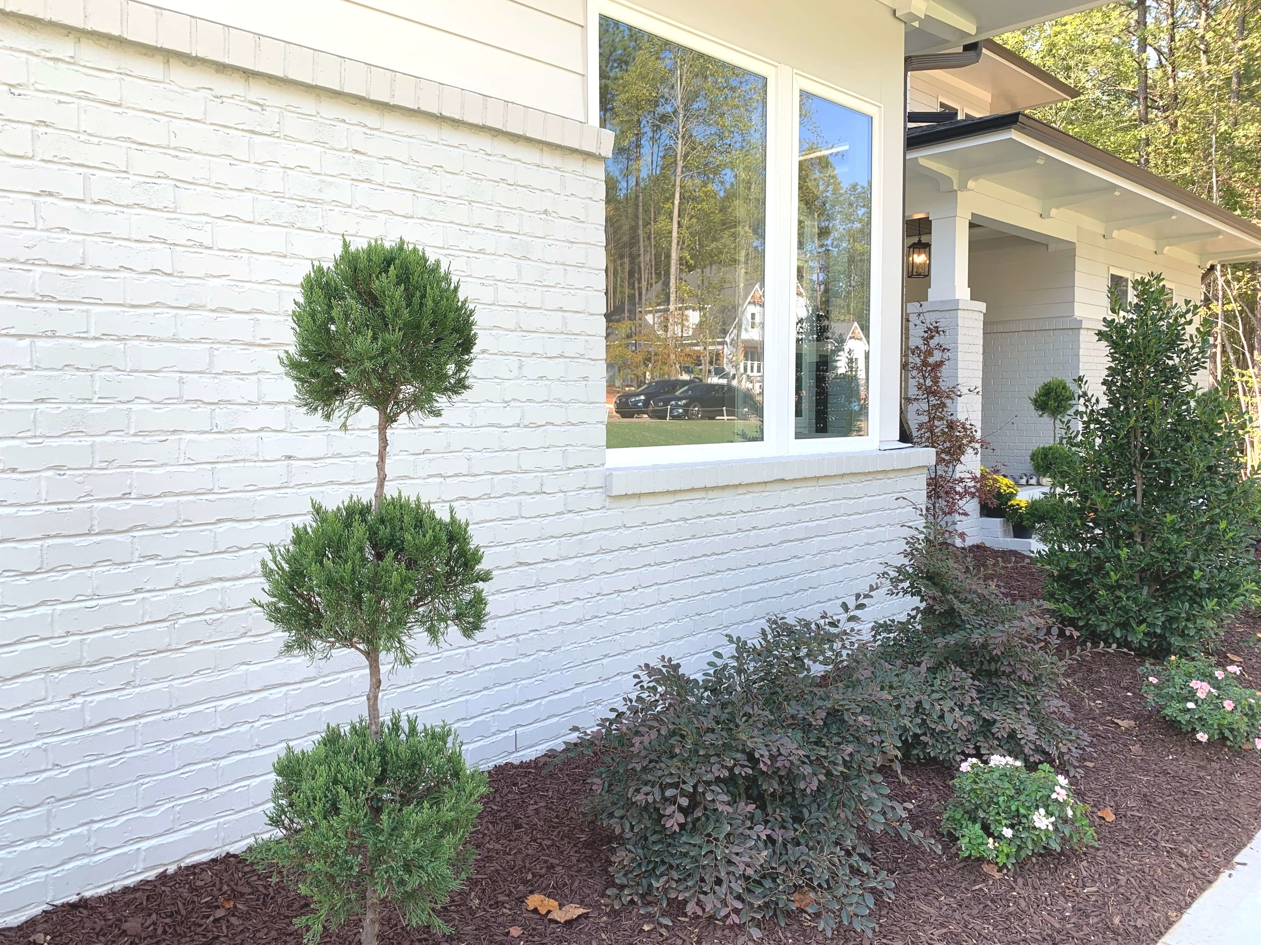 Painted brick is a big trend right now and it looks great.