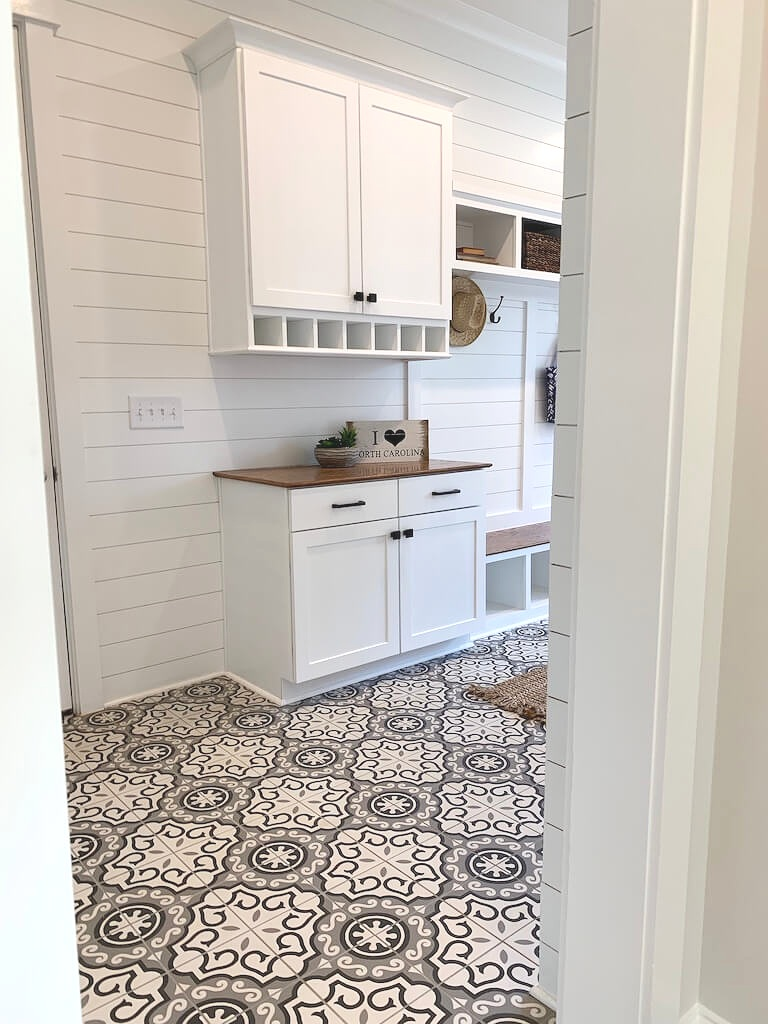 Bold tile floor, clean, white shiplap and lots of storage are excellent ideas for Mudrooms.