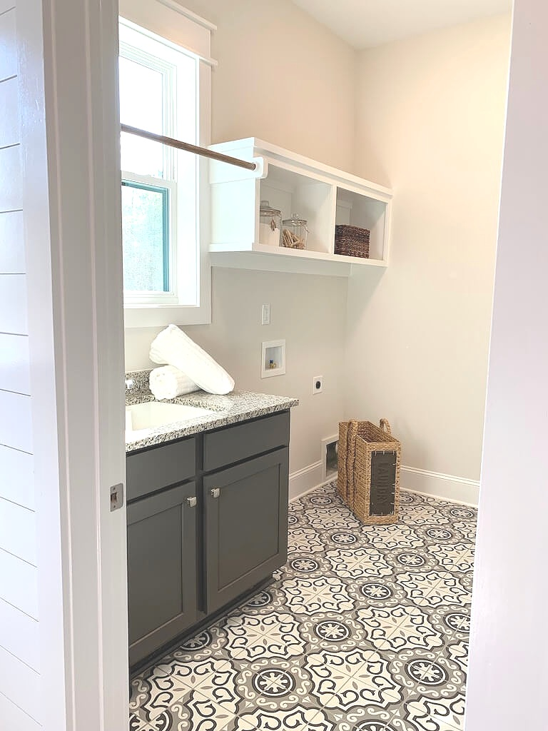 Small laundry rooms benefit from a bold pattern on the floor.