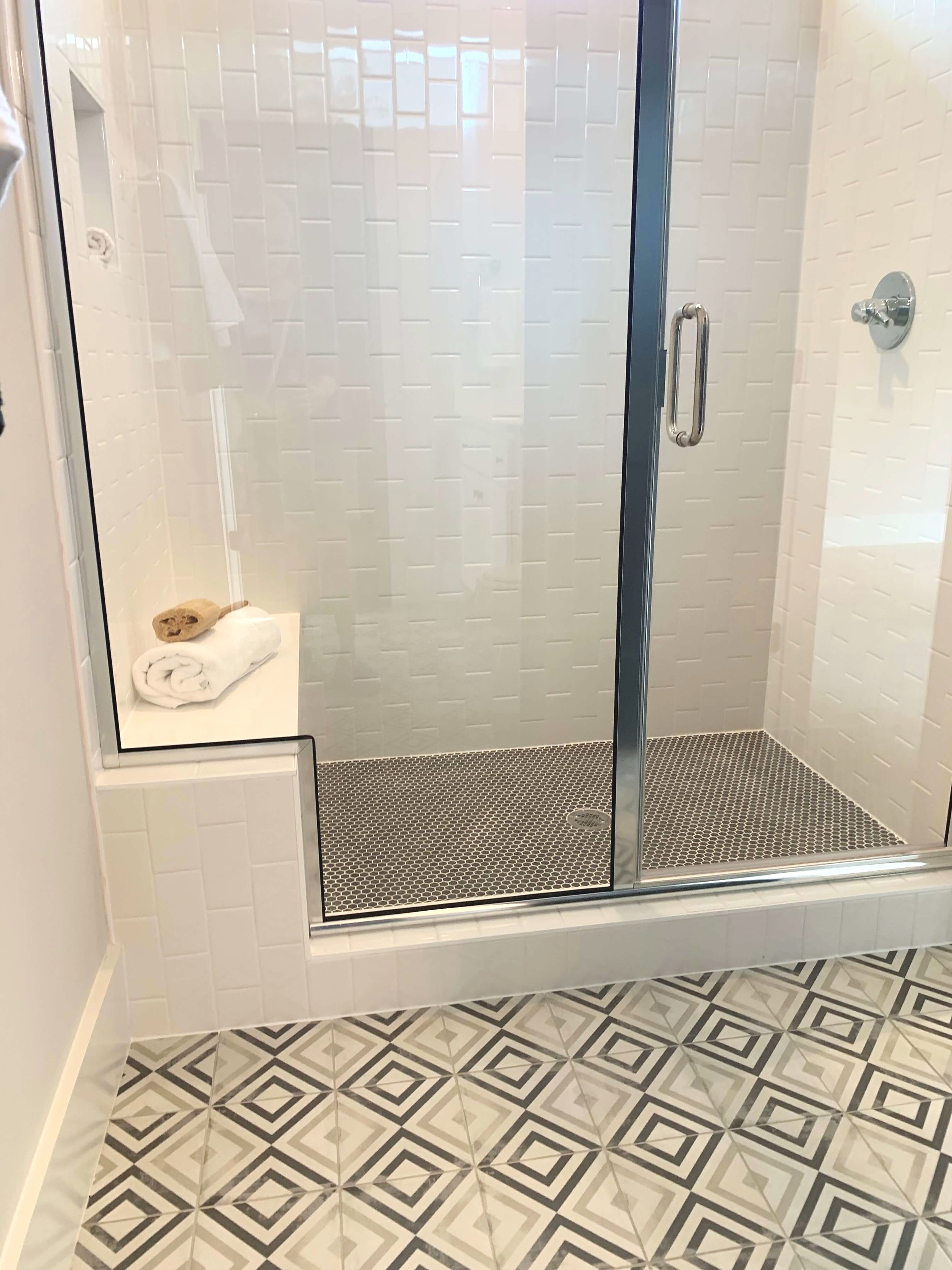 A variety of coordinating tile in a small bathroom is a great use of design time. Big impact!