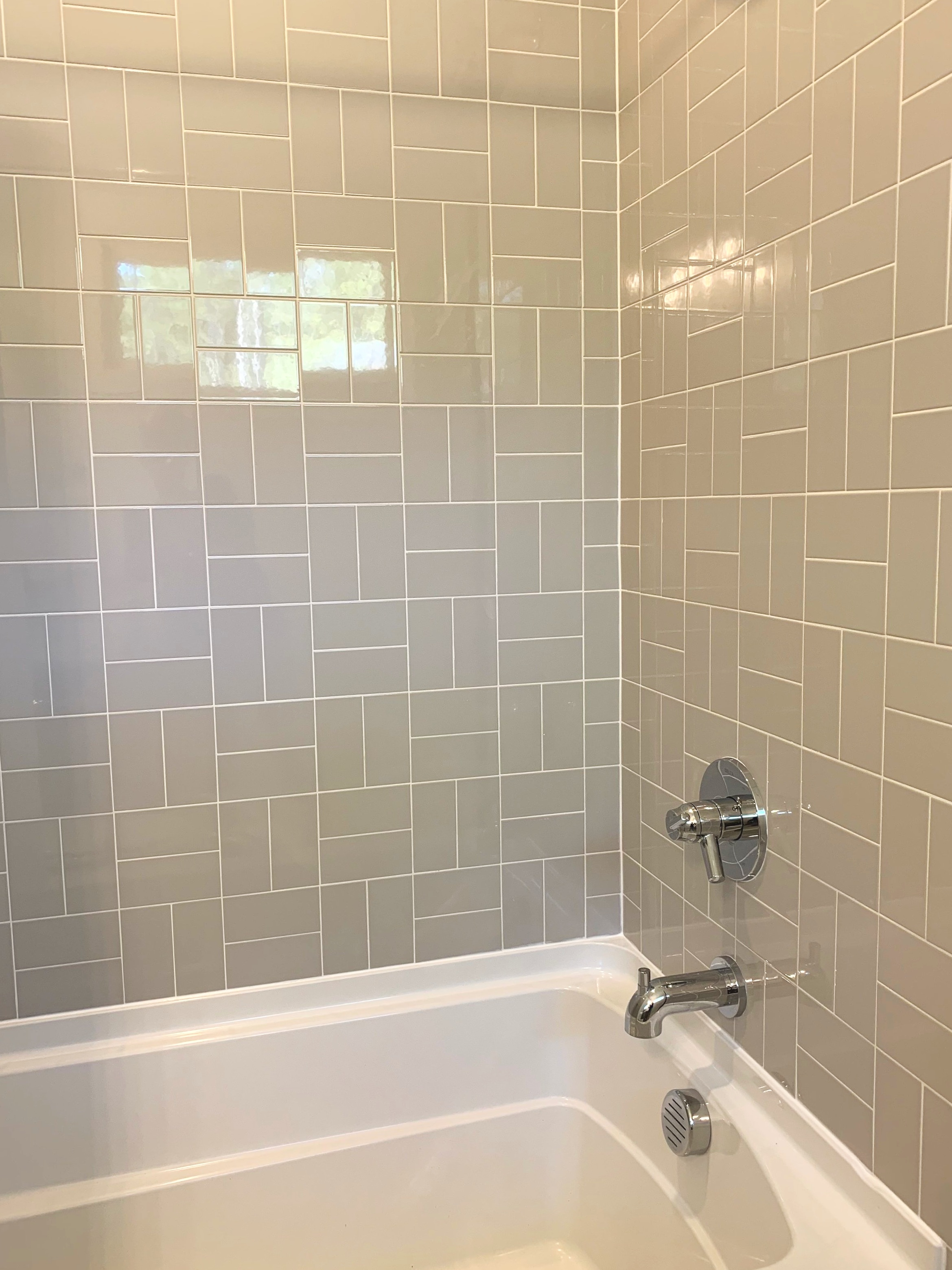 A weave tile pattern with white grout is a great design tip that I would share in a 2 hour design consultation in Raleigh.