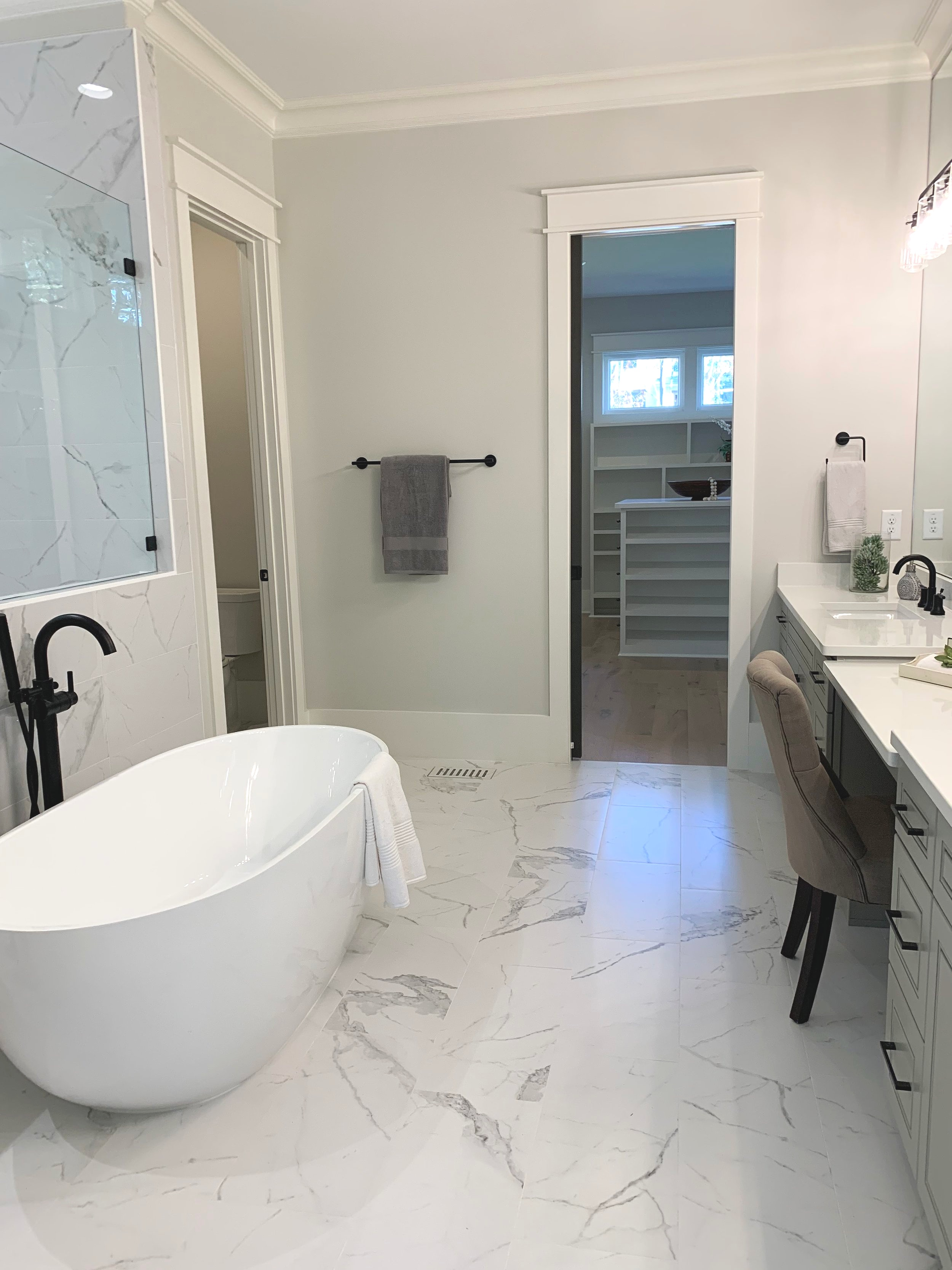 Freestanding tub, tile floor, glass shower, custom closet, master bathroom design ideas, wake forest, parade of homes.