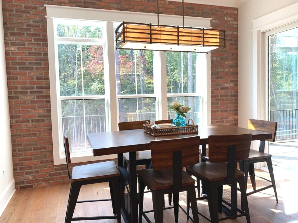 Brick accent wall, modern light fixture, mission style, great design ideas, wood floors