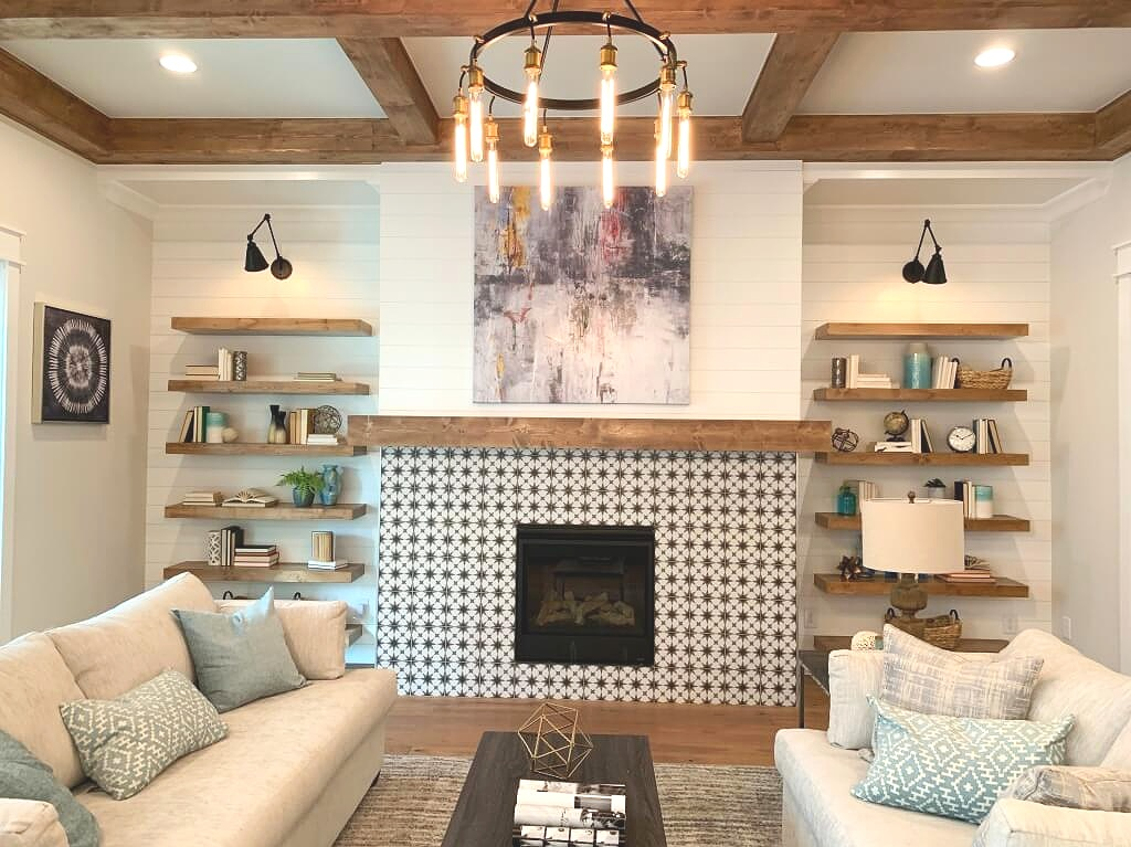 Farmhouse style home with open shelving, tiled fireplace, shiplap walls and industrial light fixture with edison bulbs.