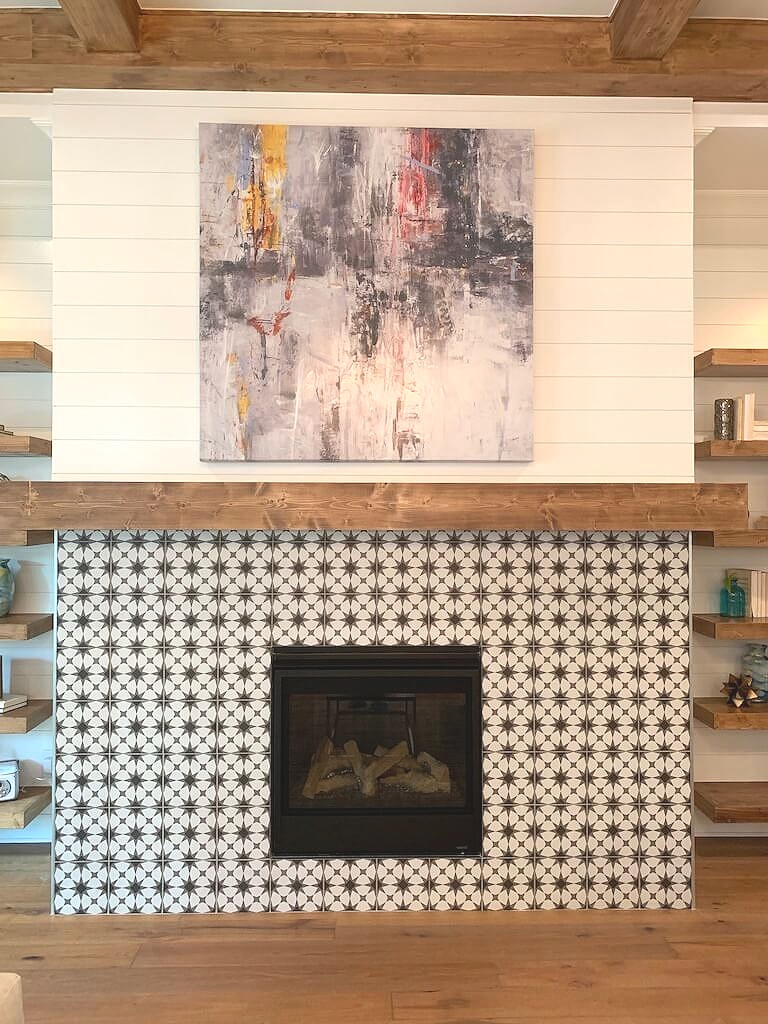 Farmhouse style tiled fireplace wall with shiplap above wood beam mantel.