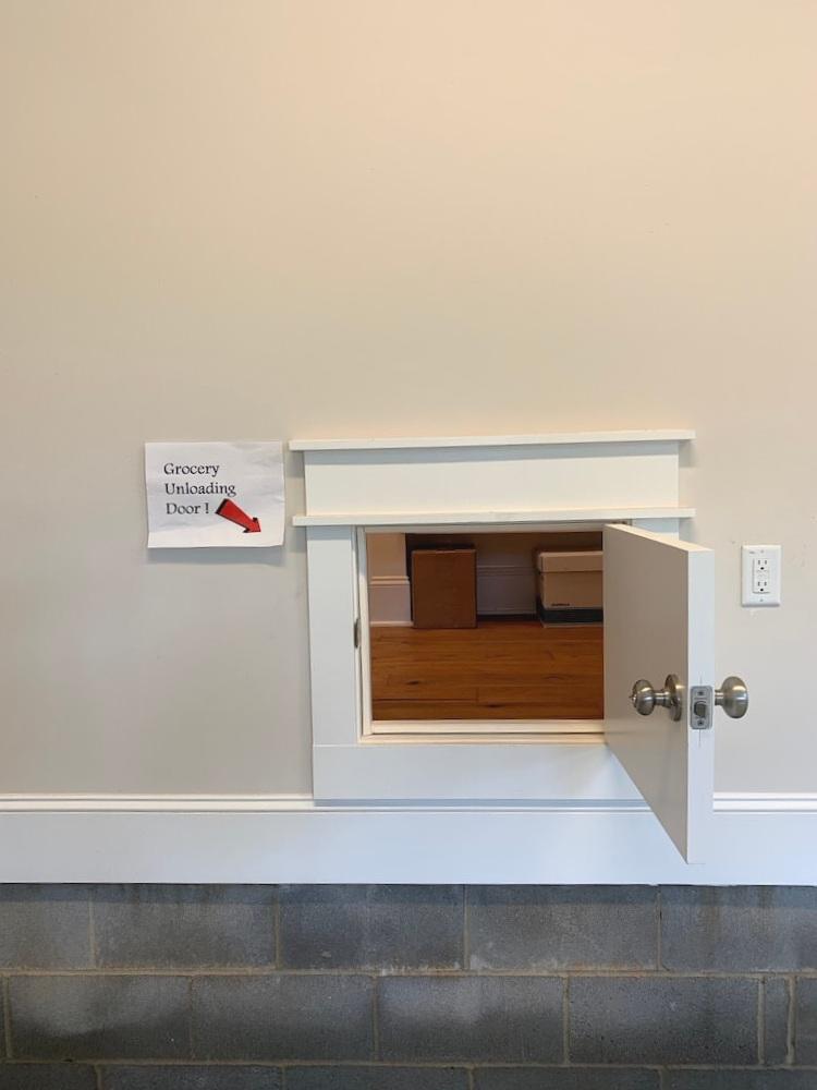 Pass through door in garage to kitchen pantry for unloading groceries.  Brilliant kitchen idea!