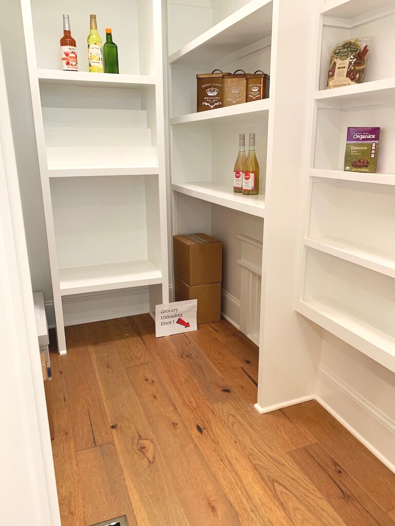 Kitchen butler's pantry with pass through opening to garage for groceries.
