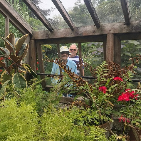 . 'Peering In' . Phil, and me again. Jeannie caught us both peering through the greenhouse pane. . . . . . #haiku by me, 📷 @jeannieclarkeartist #poet #poem #poetry #poetsofinstagram #photography #greenhouse #garden #quexgardens #quexpark