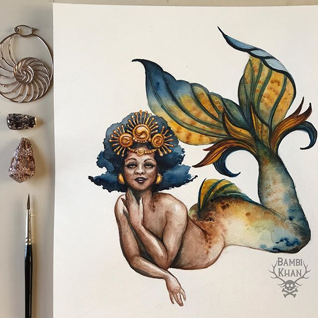 """I'm over the moon about working with @finfolkproductions to create a mermaid for their (now sold-out!) holiday box! This beauty is inspired by the absolutely stunning @jujuccummings and the """"Golden Giza"""" Tail from finfolk! . . . I am completely charmed by the finfolk company. It's founded by two Minnesotan women who have a love of the sea, mermaids, and all of their creatures in between. They work with ocean preservation groups, and their upcoming divewear line will reflect those morals. . . . It's because of the fabric tail from finfolk that I was really, and truly able to start overcoming my fear of water and the ocean, and to become a better swimmer. Sometimes it just takes the right gear to set you up for success. If you've been thinking about taking the plunge and exploring your mer-self, I highly recommend joining their pod squad and the wonderful, supportive, and inclusive community that they have built. . . . Now I need to find some mythology worthy of this painting! Any thoughts on sea goddesses or mythology who she might represent? . . . #finfolk #goldengiza #finfolkproductions #pocmermaid #melanatedmermaid  #merfolkfieldexpedition #merfolkfieldguide #alternativemermaid #feildguidemermaid #mermay #fantasyfieldguide #mermaid #merfolk #mer #fantasyartist #mermaiddrawing #mermaids #mermaidartist #mermaidsofinstagram #mermaidstatus  #mermaidfieldguide #fieldguide"""